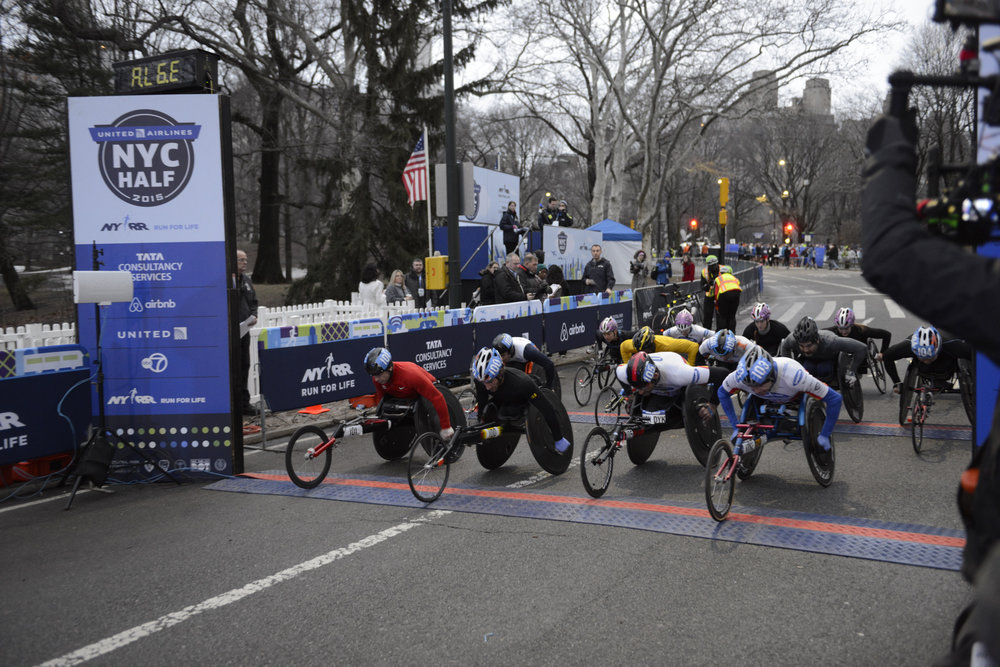 The professional wheelchair athlete field at the start of the race.