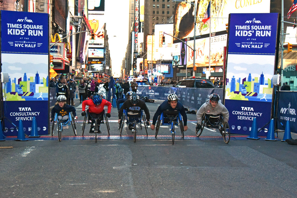 Participants in NYRR's Youth Wheelchair Training Program took part in a 1500-meter race that  started and finished in Times Square.
