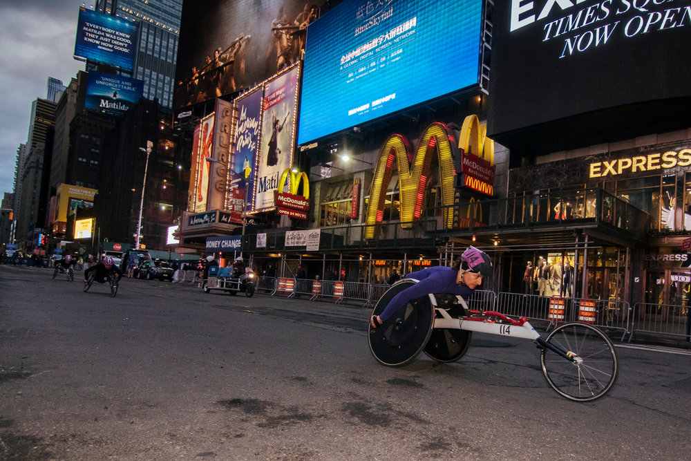 Manuela Schär of Switzerland leads the women's race through Times Square.