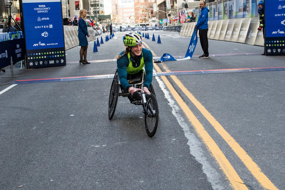 Tatyana McFadden, racing as an NYRR Team for Kids Ambassador, won the women's race in a new event record of 52:25.