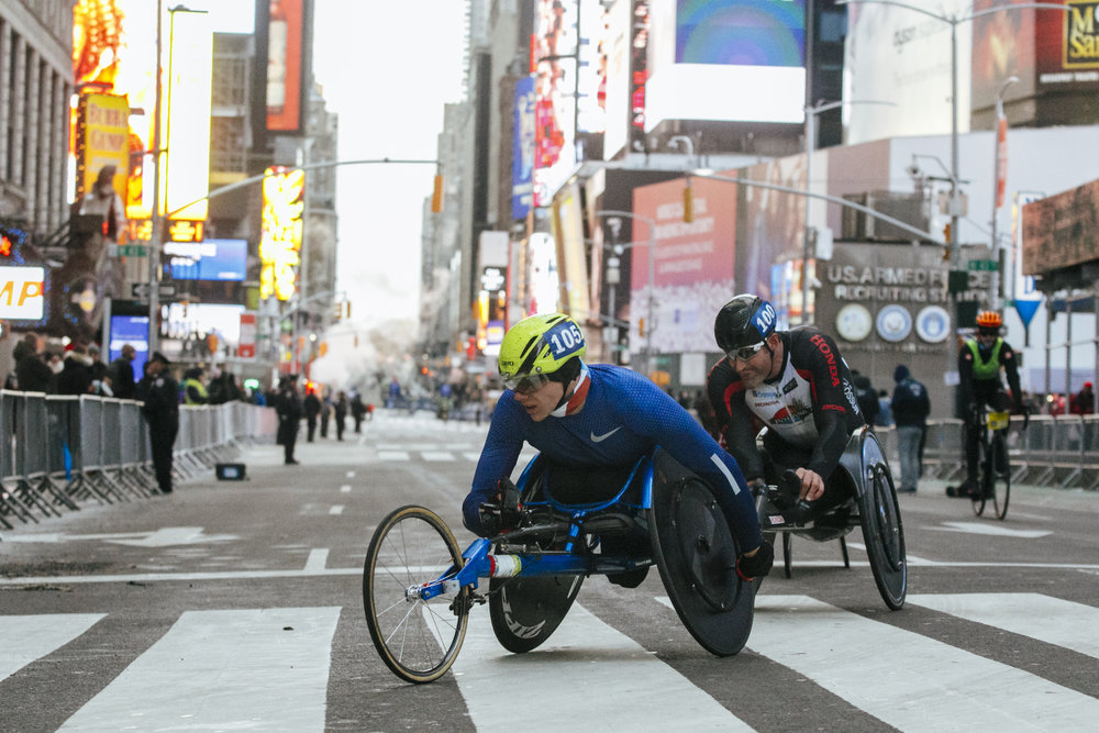 American Daniel Romanchuk at the front of the lead pack as they race through Times Square.