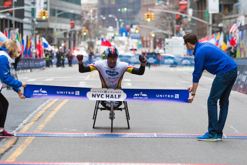 Ernst van Dyk breaking the tape at the United Airlines NYC Half in 2015...