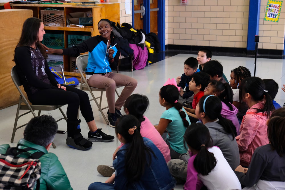 Kieffer and Saina share their running history with students from P.S. 001 in Manhattan.