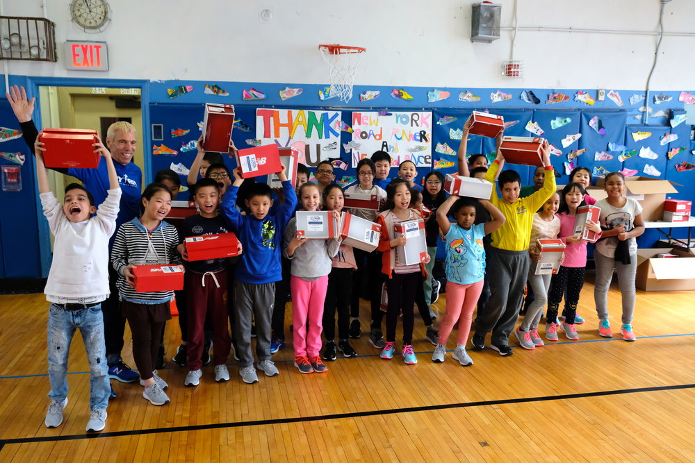 Students from P.S. 001 in Manhattan were excited to show off their brand-new pairs of New Balance running shoes.