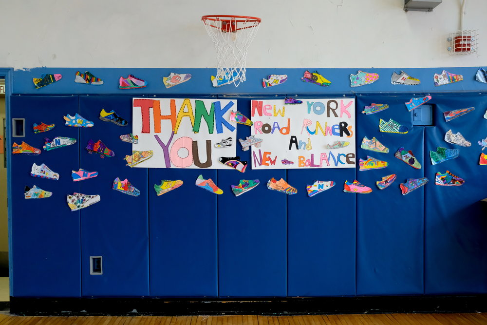 Students also decorated the walls of the school's gym with their own designs for running shoes.