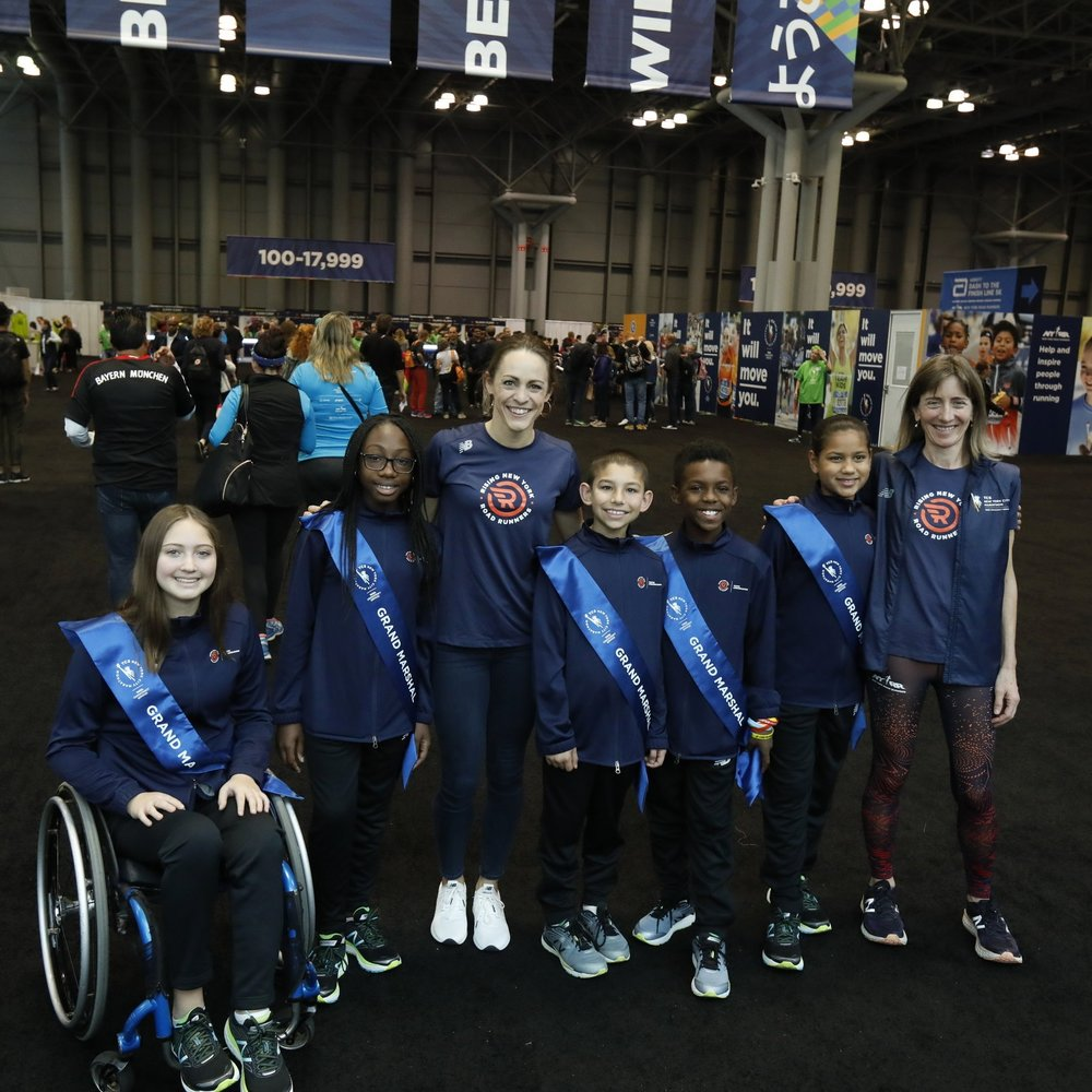 Pratt (far right); Olympian Jenny Simpson (third from left), Ambassador & Special Advisor to Rising New York Road Runners; and the 2017 TCS New York City Marathon grand marshals welcome runners to the 2017 TCS New York City Marathon Expo Presented by New Balance.
