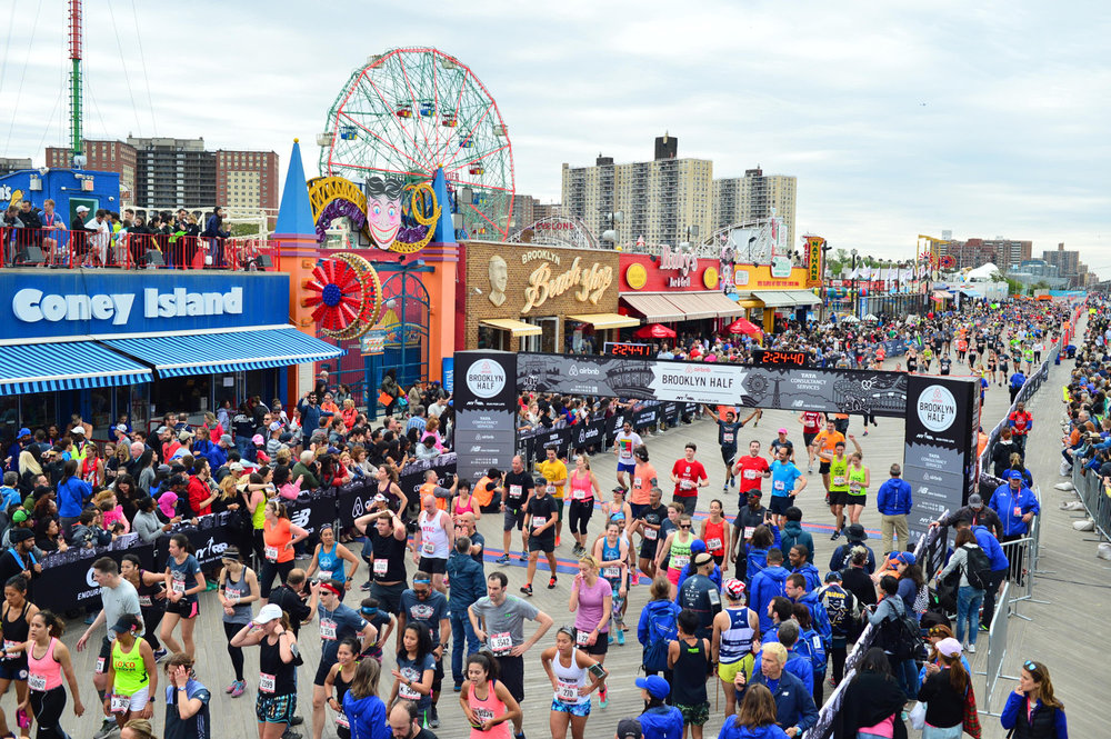 Coney Island welcomes 27,000+ runners to the Brooklyn Half finish line.