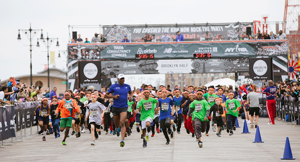 Nearly 1,000 kids have the thrill of running on the boardwalk at our Rising New York Road Runners races.
