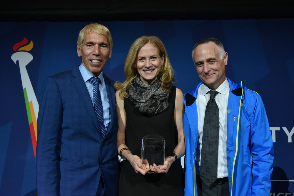 At the 2016 TCS New York City Marathon, Mary Wittenberg (pictured here with NYRR's Peter Ciaccia and Michael Capiraso) was the recipient of the Abebe Bikila Award, presented to an individual who has made an outstanding contribution to the sport of distance running.