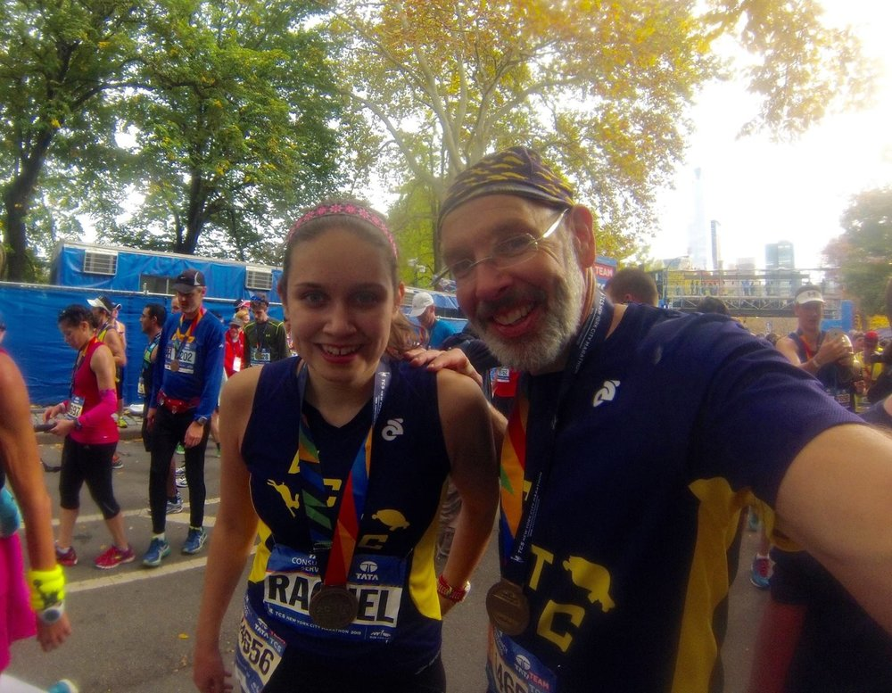 Rachel and her dad after completing the TCS New York City Marathon in 2015