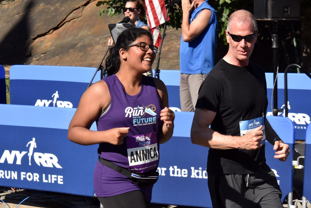 Annick's dad participates in the Percy Sutton Harlem 5K as a Race Buddy, coaching a high-schooler through her first road race