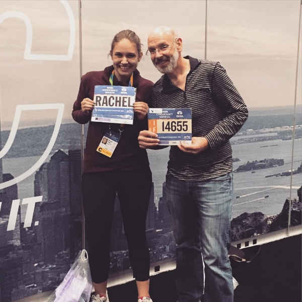 Rachel and her dad pick up their bibs for the 2015 TCS New York City Marathon