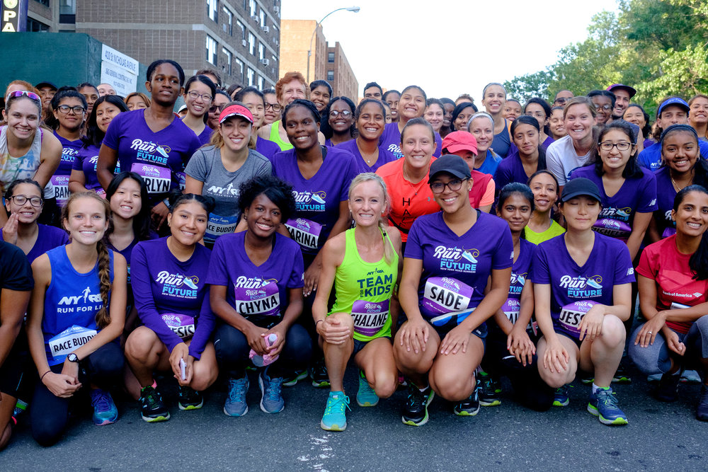 Flanagan (center, in NYRR Team for Kids jersey) with NYRR Run for the Future participants and fellow Race Buddies at the 2017 Percy Sutton Harlem 5K Run.