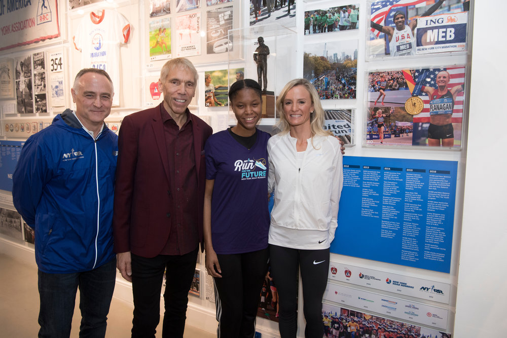 Flanagan at the NYRR  RUN CENTER in December for the 2017 NYRR Pro Performer of the Year Award Ceremony, joined by Michael Capiraso, NYRR president and CEO; Peter Ciaccia, NYRR President, Events and Race Director, TCS New York City Marathon; and Mackenzie Morrison, Flanagan's NYRR Run for the Future Race Buddy from the Percy Sutton Harlem 5K Run.