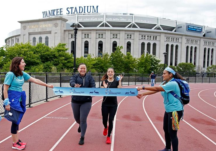 Local runners get a surprise finish line to their workout on Global Running Day.