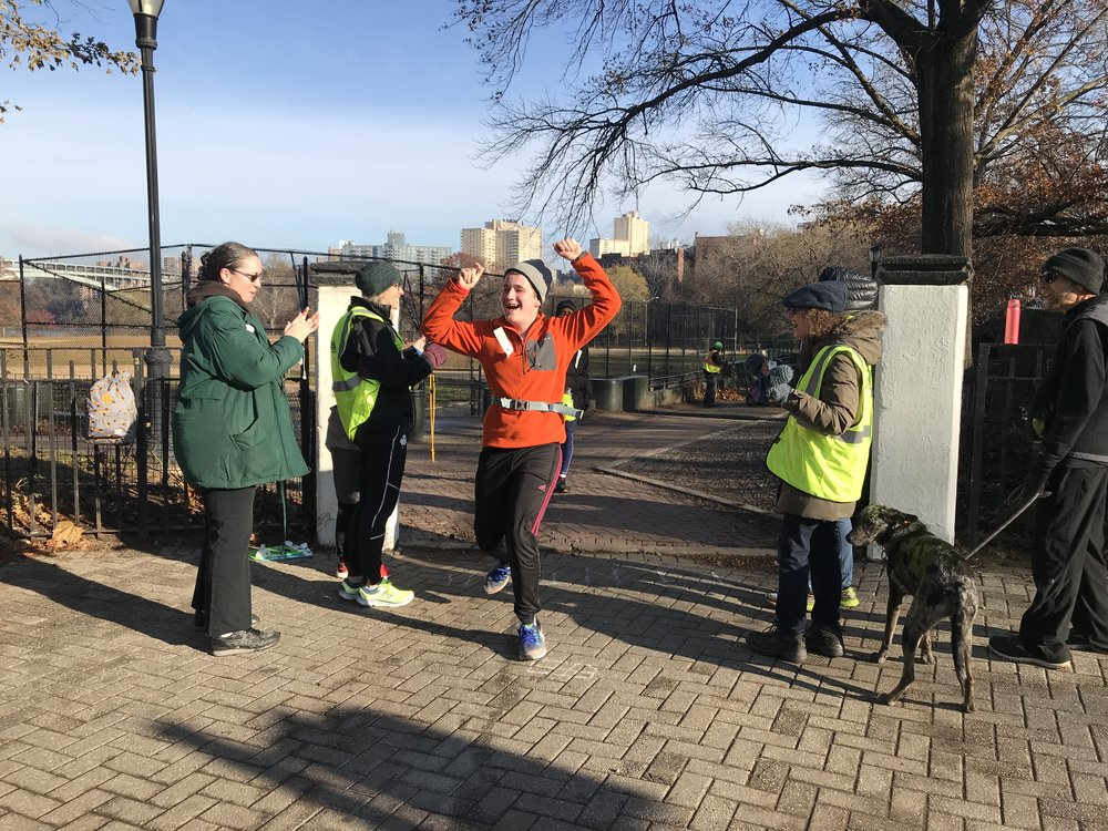 Bryce crosses the finish line in Inwood Hill Park for the 100th time on December 1, 2018.