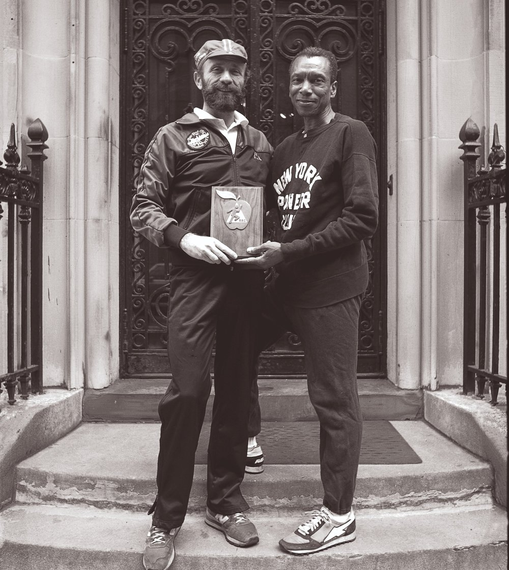 Ted Corbitt with Fred Lebow in front of NYRR headquarters in the 1980s.