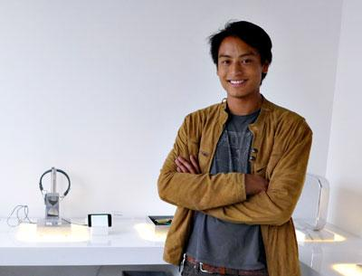 "Evan Desmond Yee in front of his installation ""The App Store"""