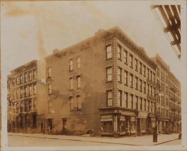 Ninth Avenue at S.E. corner of 46th Street, showing also 370-372 West 46th Street. About 1920. James Suydam. New York Public Library's Irma and Paul Milstein Division of United States History, Local History and Genealogy.
