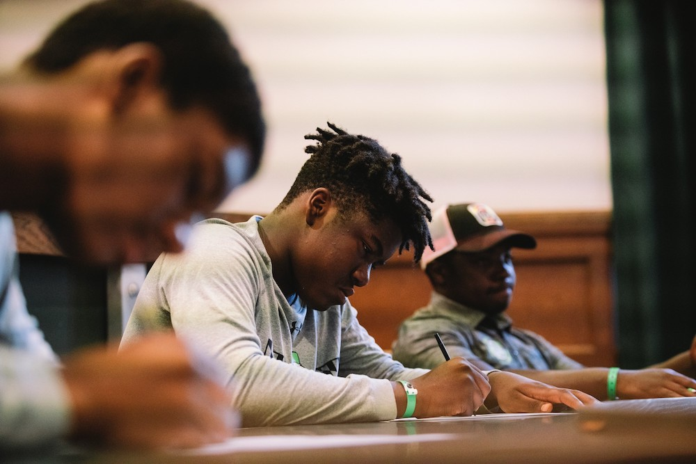 Young African American boys taking a test