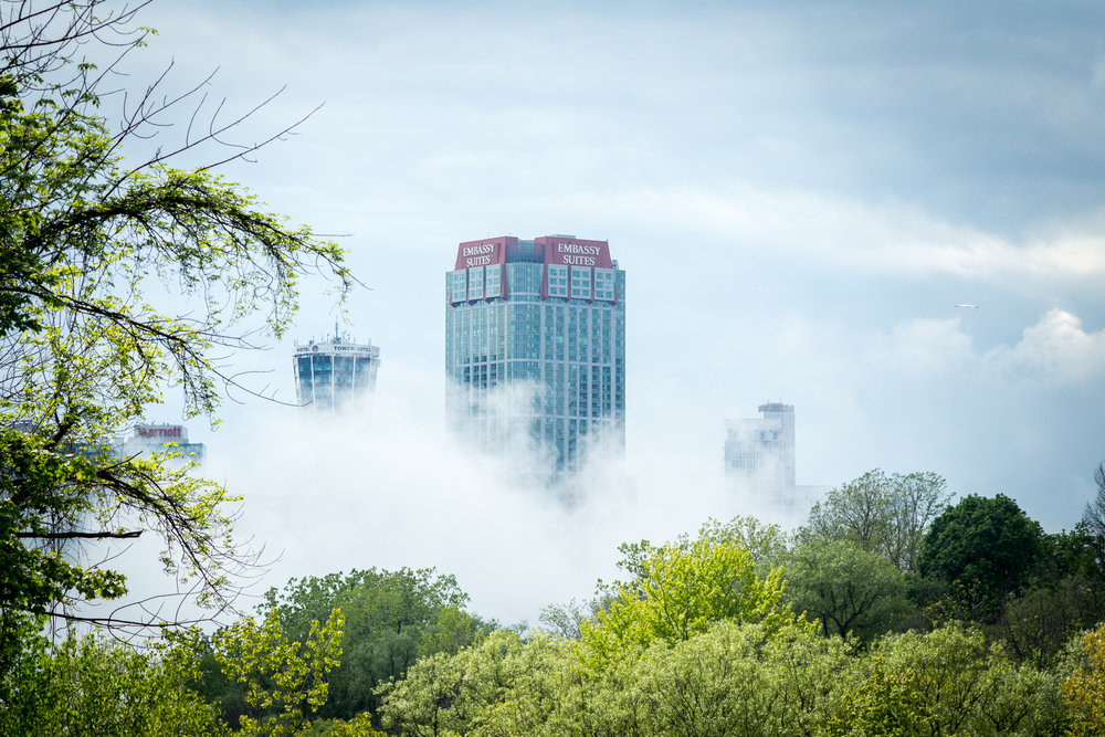 The spray from the falls seemed to engulf the surrounding buildings.