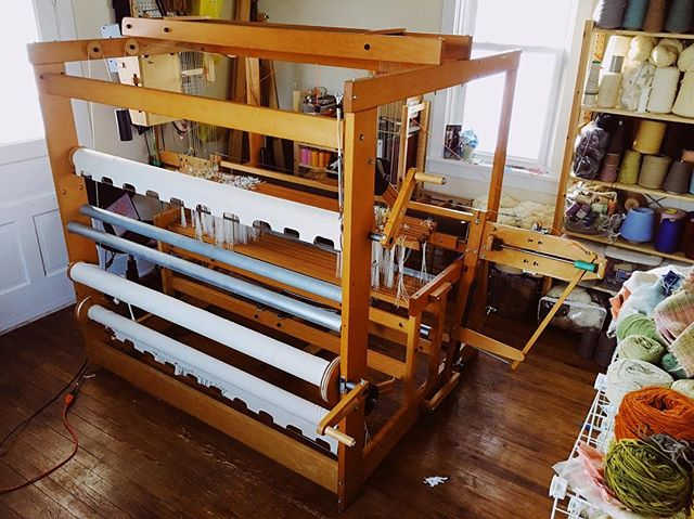 A few weeks ago I rented a U-haul and drove to Michigan in an ice storm for this loom. ❄️ After numerous hours of putting it together, replacing cables, and figuring out the computer (it's a computer controlled loom) I got it working! Super excited to get a warp on and start weaving. ✨ The last picture is the original owner of the loom, Geraldine Z. Single. Her husband donated the loom and all her notebooks to Eastern Michigan University after she passed. I'm feeling grateful to be this looms current owner. #handweaving #weaving #loom #warped #avllooms  #weavingadventures