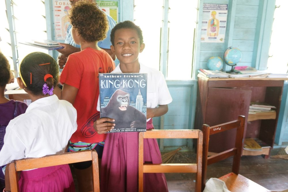 Student at Ravitaki Primary School with a new book.