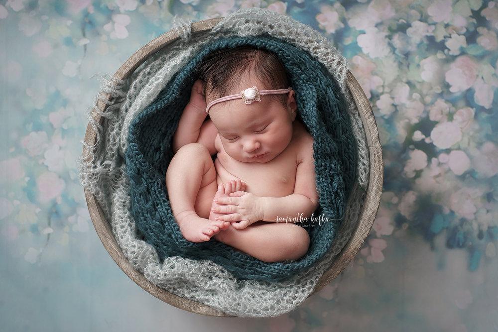 Little baby snug in bucket