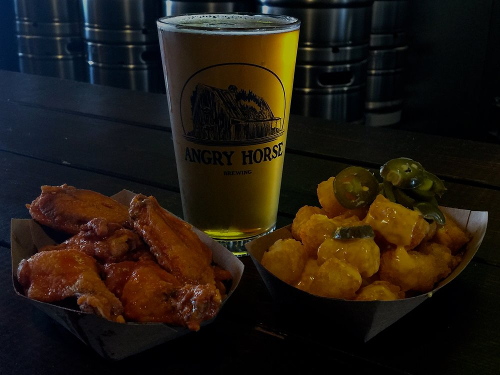 Our For the Helles of it paired with their limi chili hot wings & jalapeño cheese tator tots