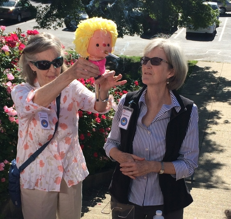 Sharon Klees RN, Donna Chacko M.D., and  Smokey Sue , a smoking doll used to demonstrate the hazards of smoking.