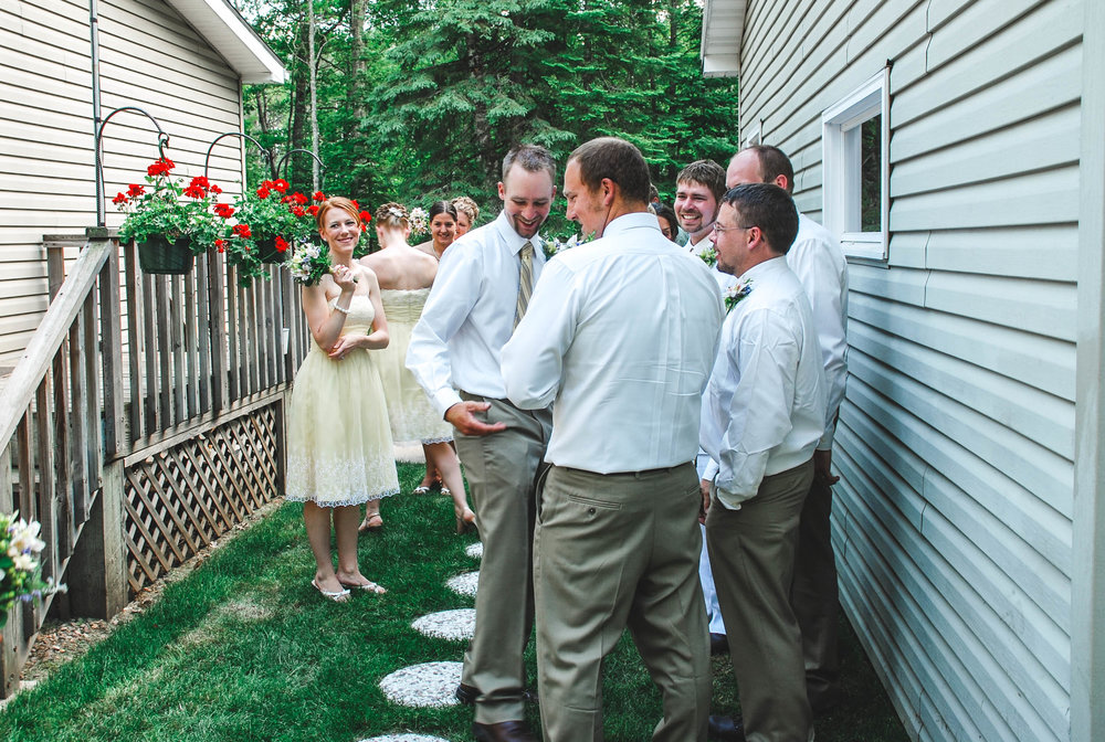 Wedding party waits for receiving line outdoor WI wedding