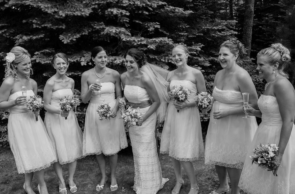Outdoor wedding; bride and bridesmaids