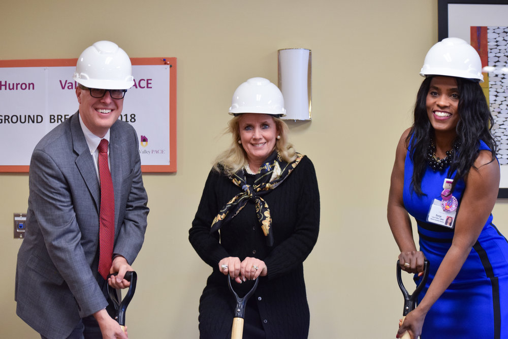 Debbie Dingle with two others wearing hard hats and holding shovels