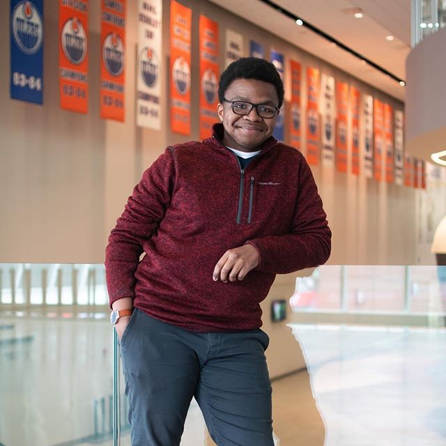 YEGbyYouth feature of Matthew in his favourite spot Rogers Place and wants to encourage people to check out the awesome events there and admires the beautiful architecture photographed by @jasonn.tran