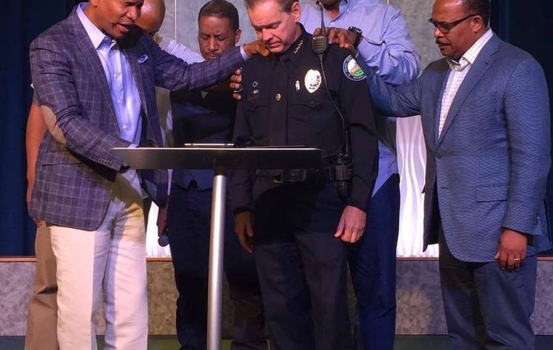 The image that started our friendship. Pastor Jenkins and the Eagle's Nest leadership praying for Police Chief Grant.