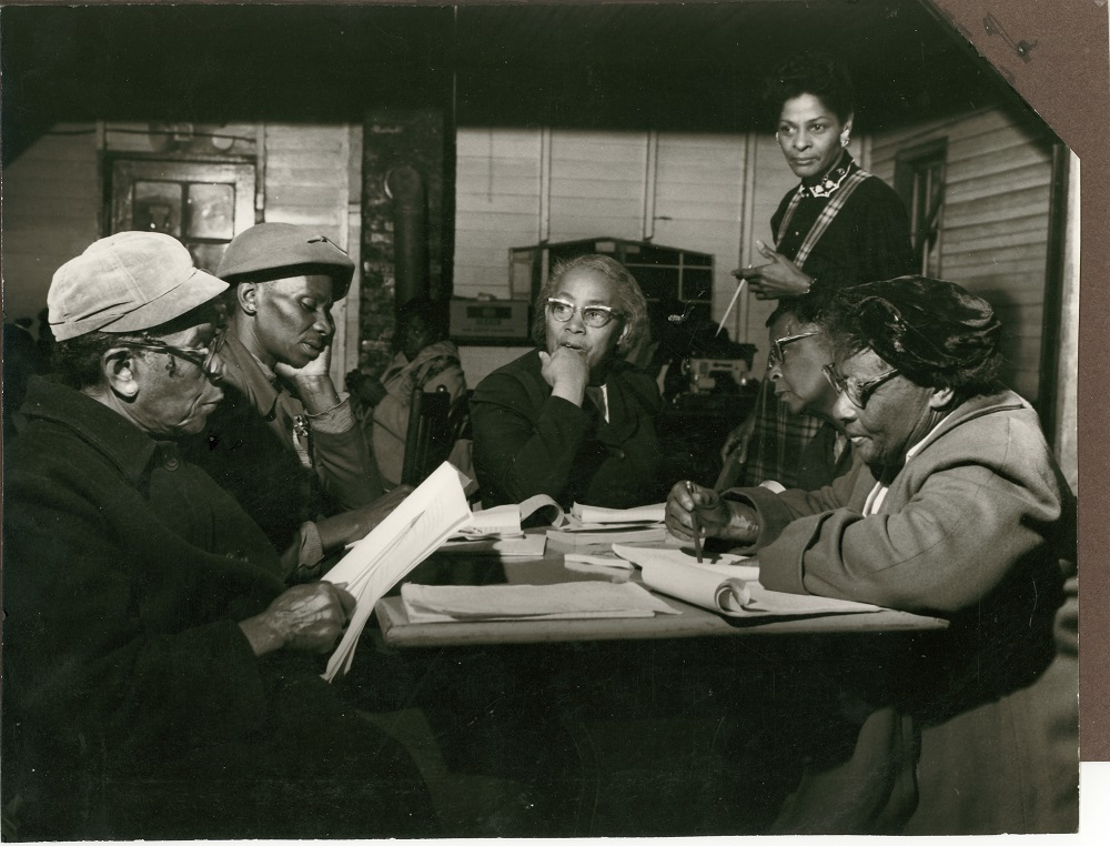 Alice Wine, Septima Clark, and others at a meeting.