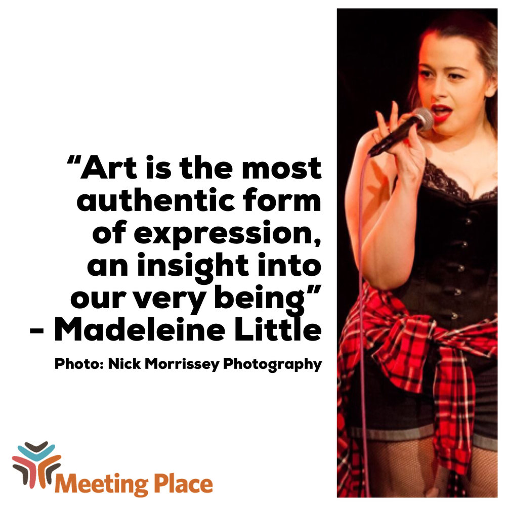 """[Image description: white graphic with a photo of Madeleine Little performing in a black corset, denim shorts, and a red flannel tied around her waist. She is holding a corded microphone in one hand and is speaking. To the left of the photo is text that reads: """"Art is the most authentic form of expression, an insight into our very being."""" Quote is attributed to Madeleine Little. In the bottom left corner of the graphic rests the Meeting Place logo.]"""