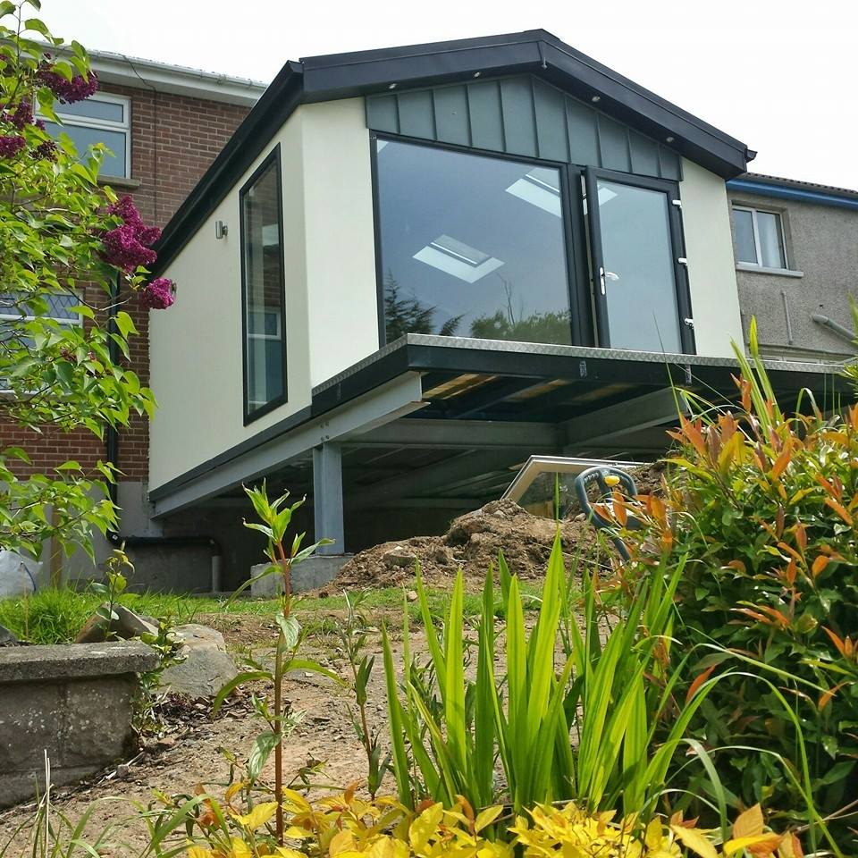 Superb A Rear Extension Above A Sloped Garden.
