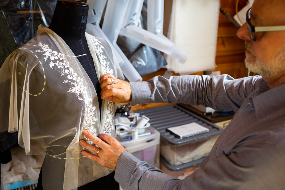 Fitting your custom designed wedding dress.