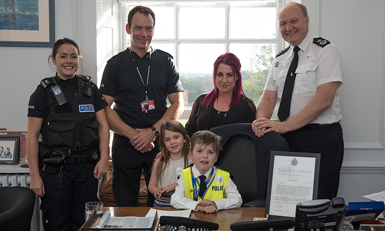 Danny at Sussex Police weith PC Laura Marmolejo, Chief Inspector Marc Clothier, Chief Constable Giles York, Mum Fran and Sister Sky.