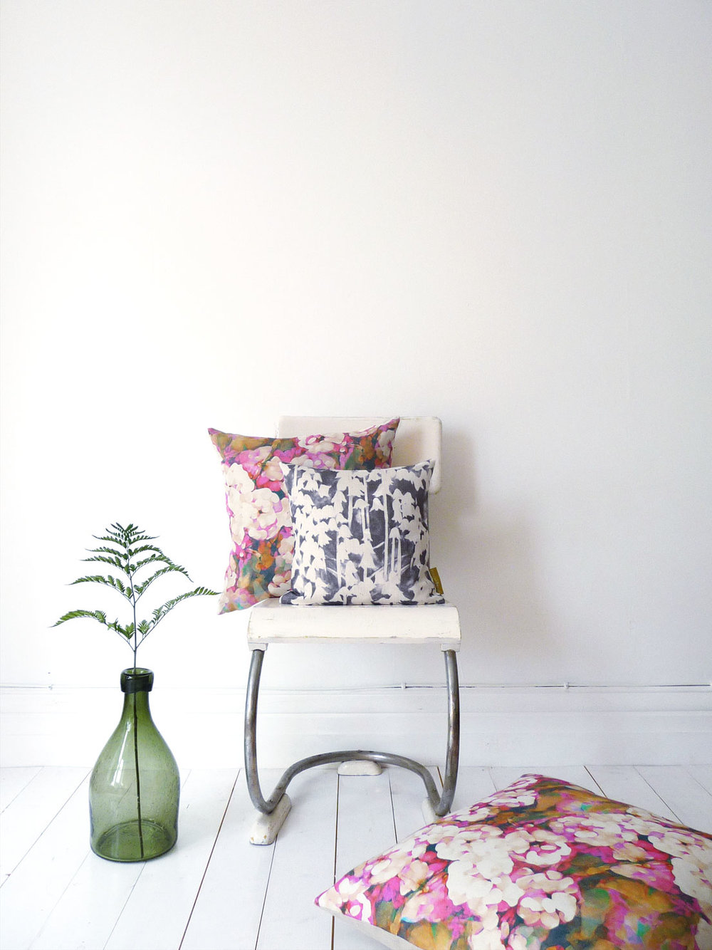 Imogen Heath Rosa pink and Bluebell luxury interior fabrics as cushions bringing colour to a neutral space