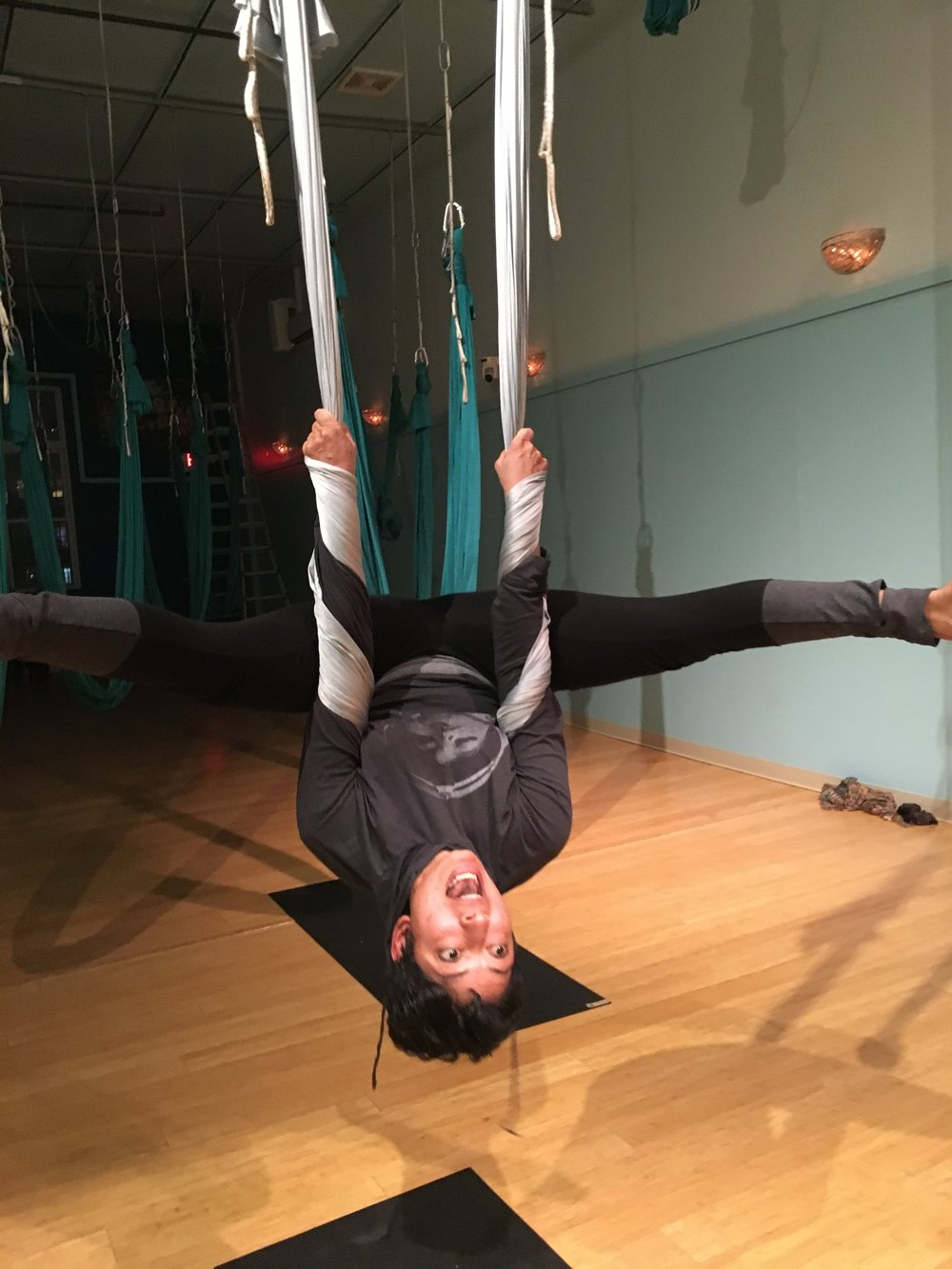 This is also an inversion. A supported inversion in aerial yoga.   Photo Credit: The friendly folks, aka Kennedy, at my local yoga studio, go Jivamukti JC!