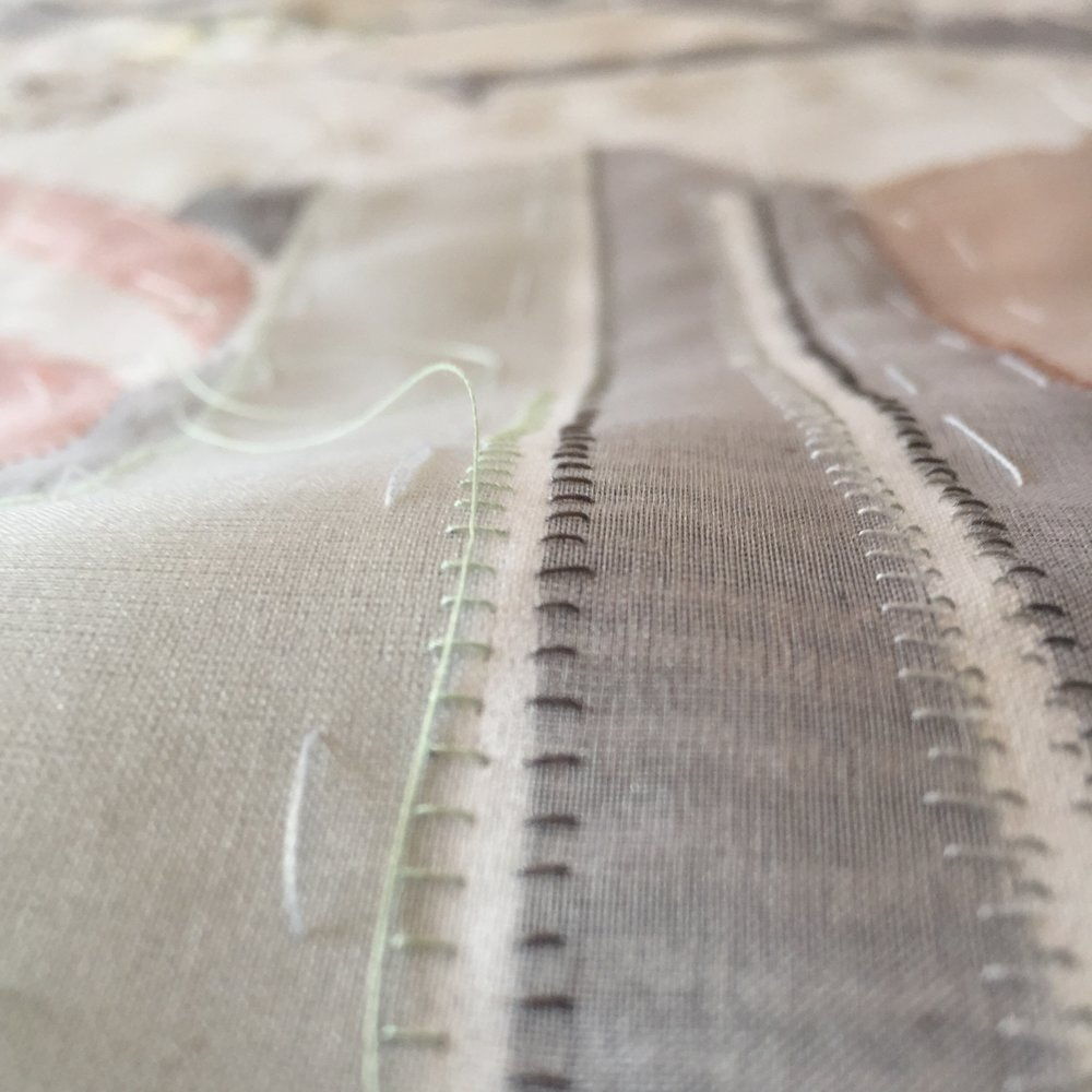 The pieces are hand stitched together with different coloured threads.