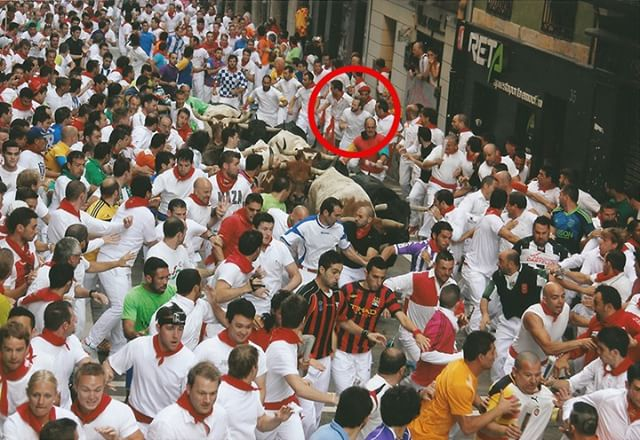 A pic of me running with the bulls in Spain in 2013. . Terrifying & exhilarating... but most of all a unique chance to REALLY know your relationship with fear (a guy next to me fainted before the run even happened, and we had pass him over to the medics like a mosh pit moving the rockstar over to the side of the fences). . To read the full write up of my experience see link in bio. . #sanfermin #runningwithbulls #spain #españa #toros #bravos #lacorrida