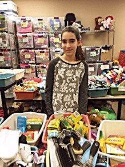 Ella organizing a collection drive involving friends and family to see her mission of supporting youth in foster care come to fruition.