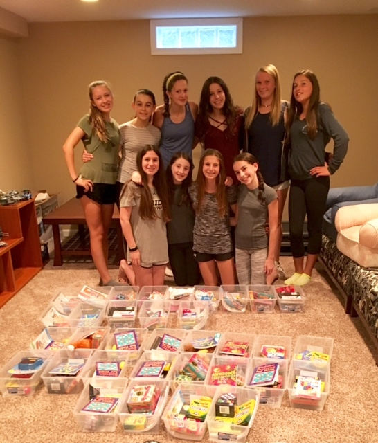 Zoe and friends assembling Jared Boxes for their peers at Children's Hospital.