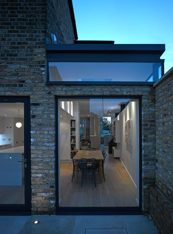 Bi Folding doors have taken a back seat for black frame floor to ceiling window and door.
