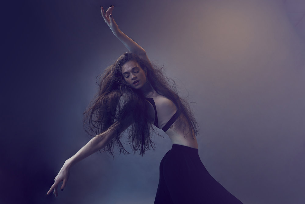 In thumbnail and this photo, dancer Emily Dixon Alba plays the Little Match Girl Photography: Will Graham