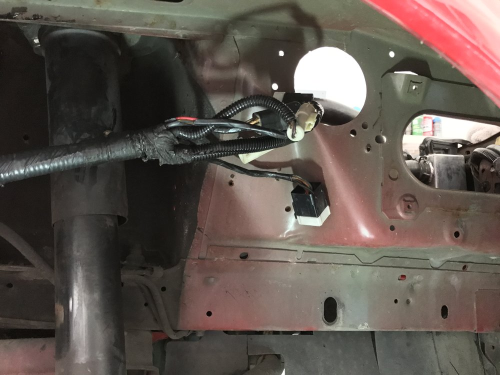 You can see the mass airflow harness reaches the same area, just on the other side of the fender apron. The only connection that will not reach is part of the starter harness.