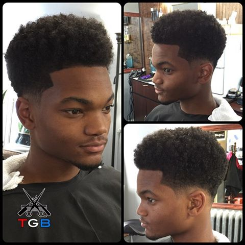 "Always fresh cuts coming from The Gentlemen's Barber Shop! Here's a clean tapered loose Afro by Michael. Jrew wears this hairstyle with a clean razor edge-up, a bald radial taper on the sides, and back.  To book an appointment with Michael or one of our other talented barbers: -Download our free app @ http://thegentlemensbarber.mobapp.at/ -Visit thegentlemensbarber.com and click ""Book an Appointment"" -Click the ""Book Now"" button here on Facebook or through Yelp. #barber #barbershop #Afro #hairstyle #haircut #barberpride"